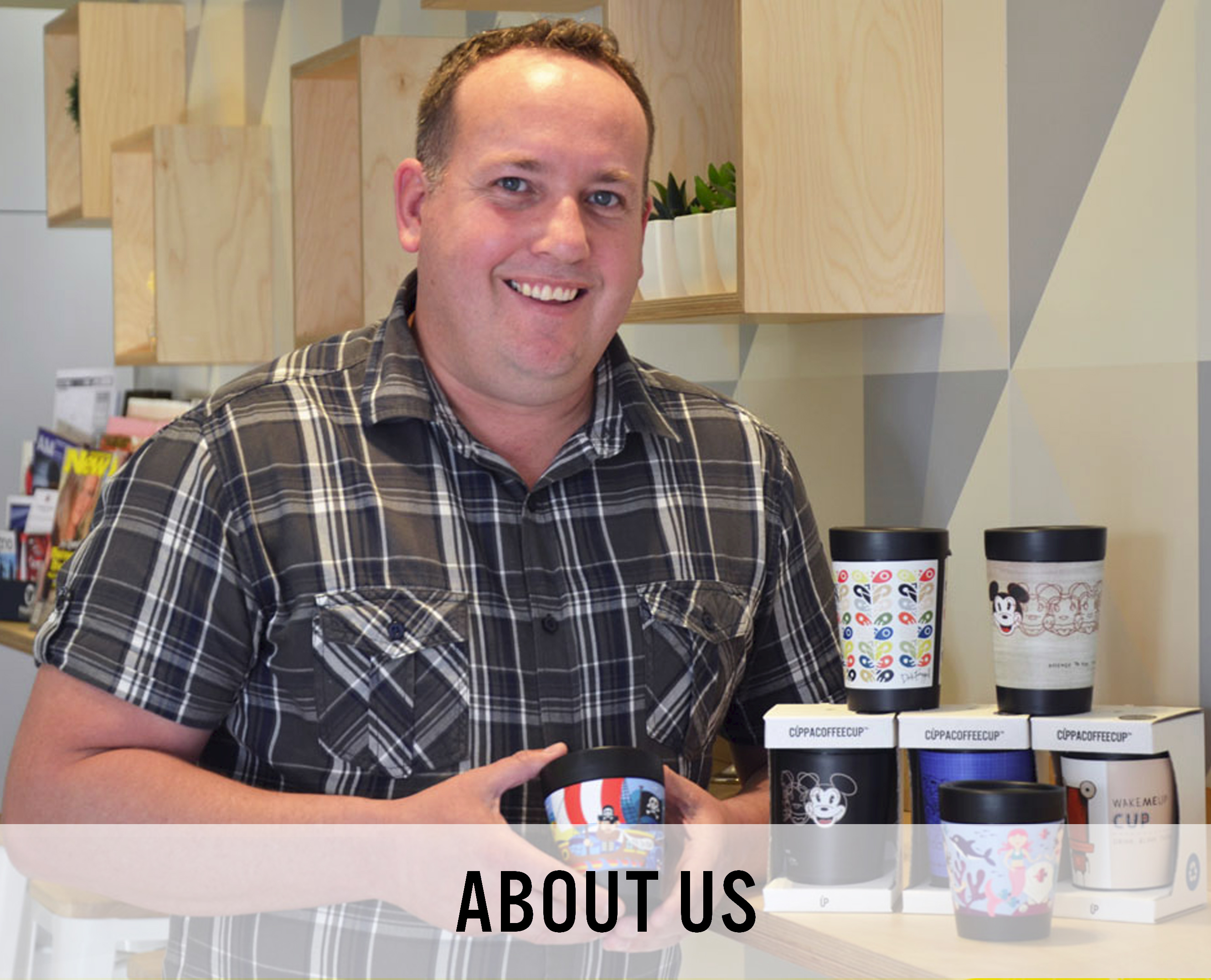 A picture of Darren Turner, General Manager of Cuppa Coffee Cup holding a Recyclable Coffee Cup
